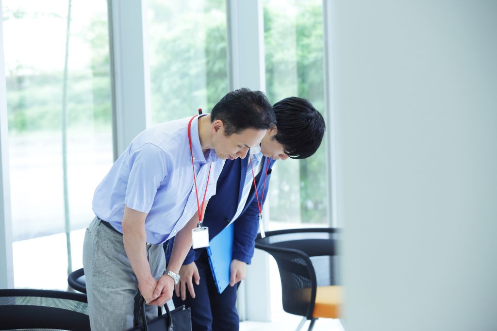 Japanese business people bowing