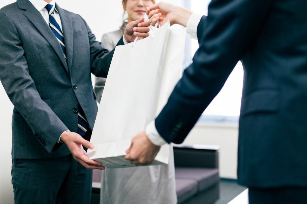 Japanese business person giving a gift to a client