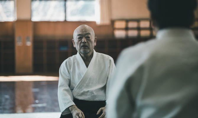Aikido Master sitting in Dojo