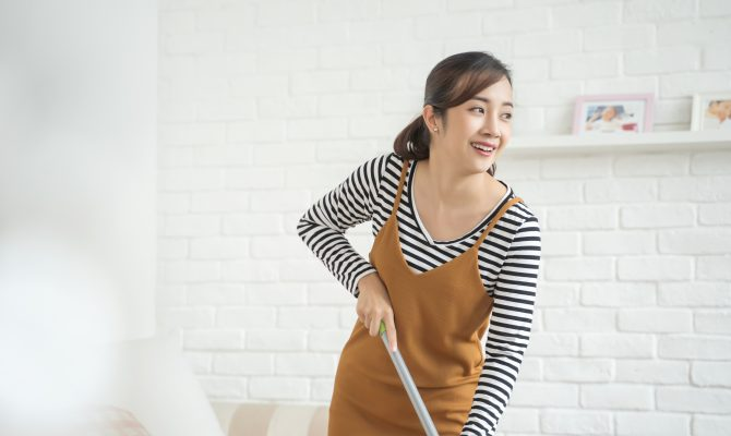 Japanese woman cleaning the house