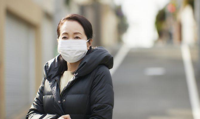 Japanese lady wearing a mask, smiling