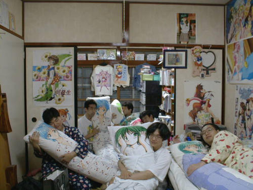 Several Otakus holding body pillows of their waifu (favorite female characters)