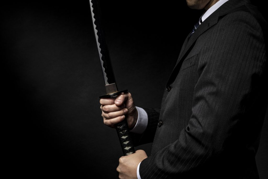 Salaryman Holding a Samurai Sword