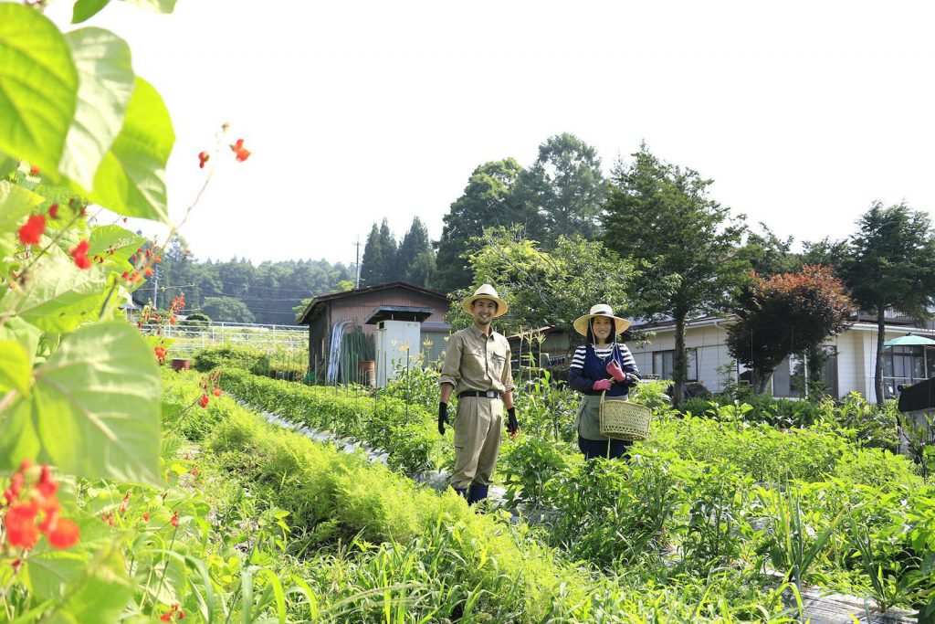 This couple grows most of their own vegetables in the countryside.