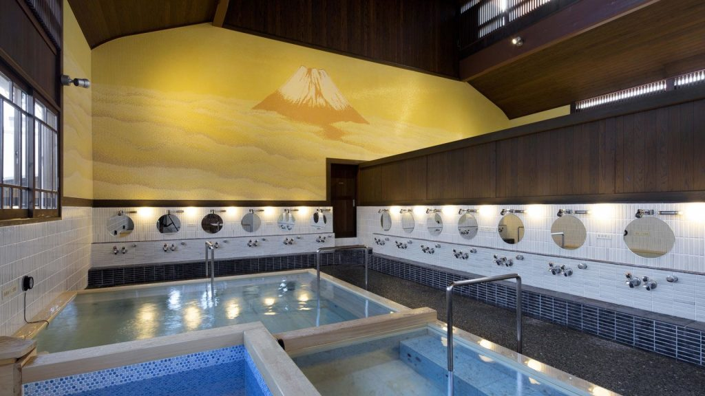 Typical public bath or sento (銭湯) in Japanese, Image Sourced from Tokyo Keizai Online
