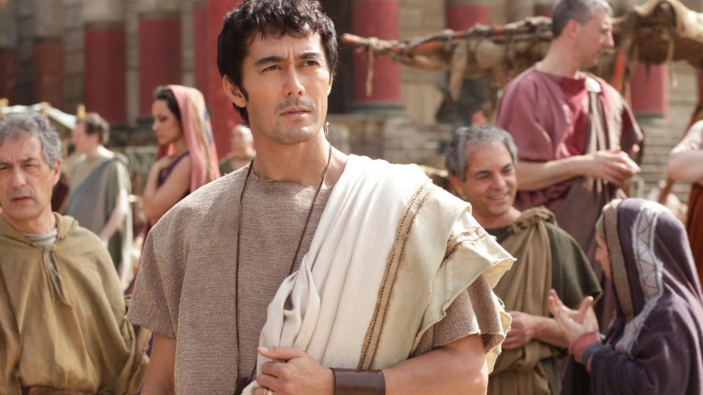 #1 Hiroshi Abe (center), Age 57, played the leading role in a comedy called Thermae Romae in which a Roman architect supposedly time traveled to modern day Japan for inspiration to build bath houses in Rome, Image Sourced from Binged